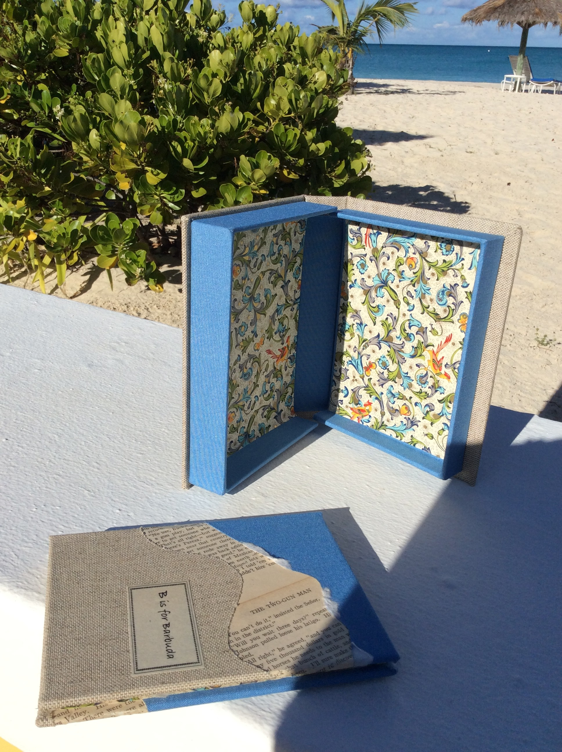 A unique artists book that is an abecedarian cataloging vacation island pastimes on Barbuda.  Altered book pages, Goya, ink jet print and hand drawn illustrations bound in book cloth and altered book with clam shell box.