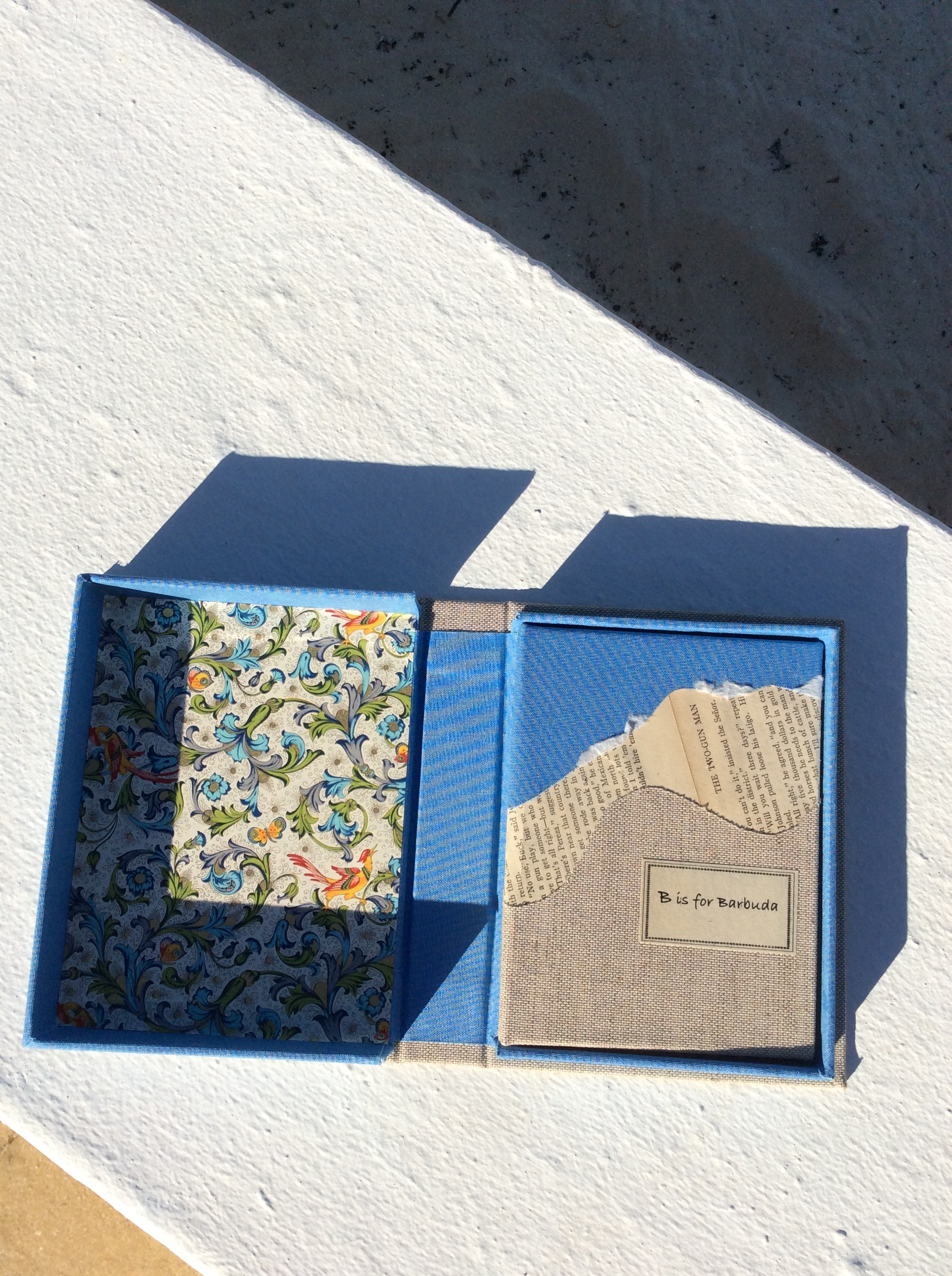 B is for Barbuda book inside open clam shell box