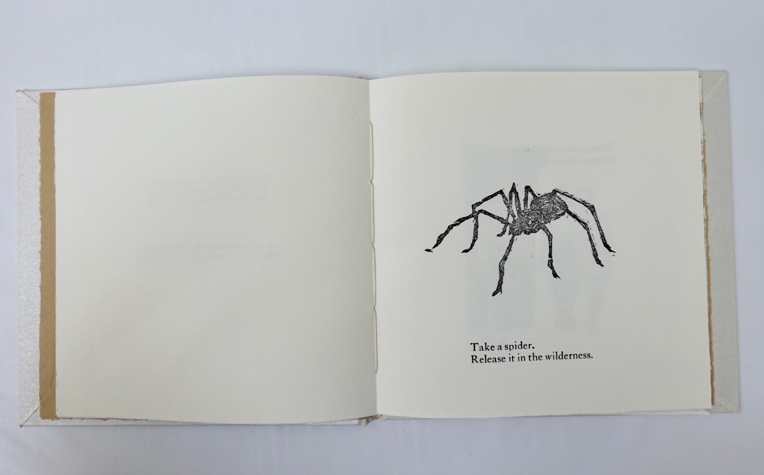 first page with spider wood cut relief