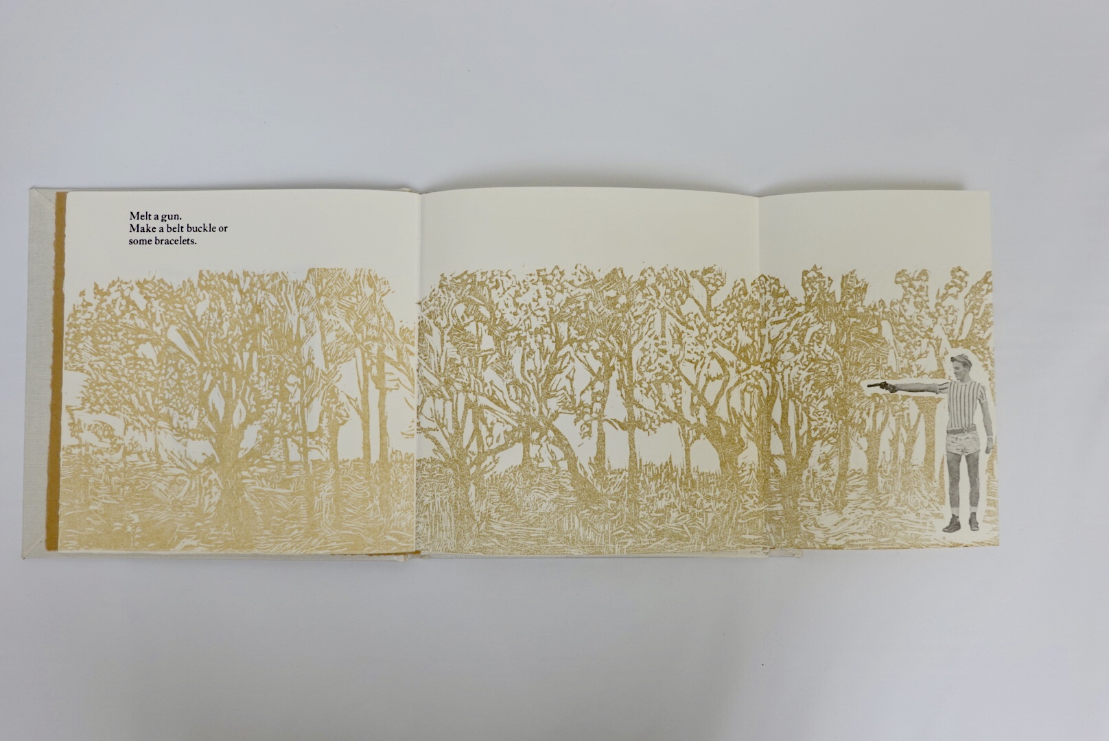 third page with woodcut relief of trees and fold out of boy image