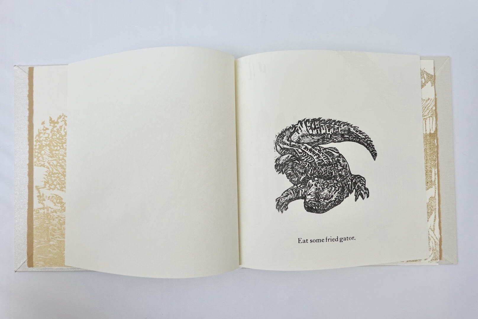 fourth page with alligator wood cut relief print