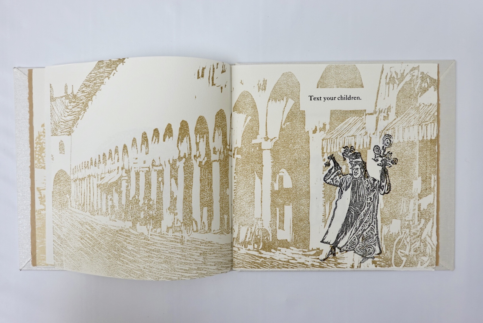 fifth page with background architectural image in wood cut relief and Child Catcher wood cut relief