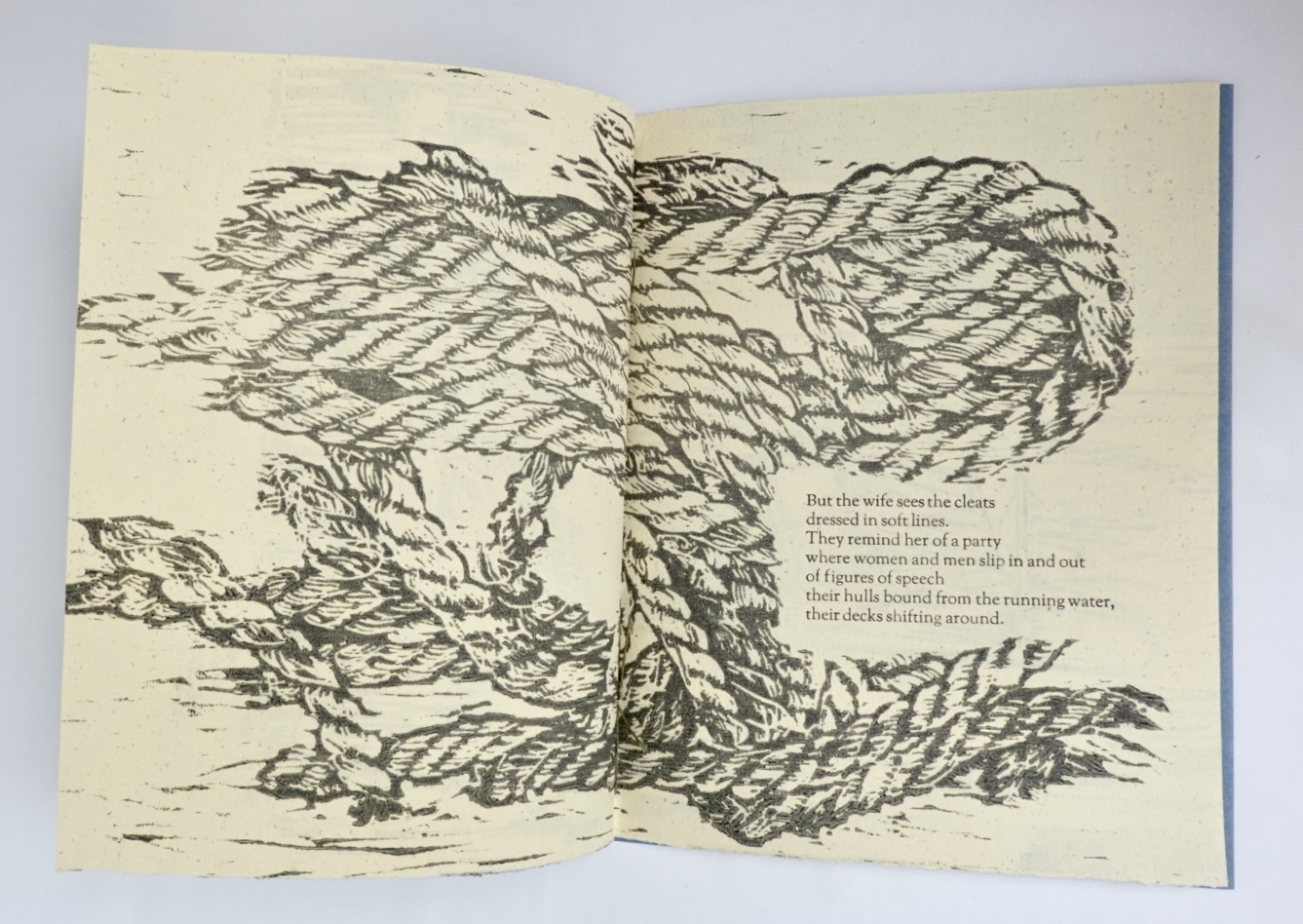 third/fourth pages with wood cut relief imagery and second stanza of poem